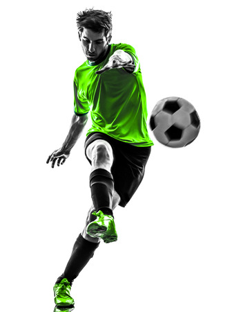1: one soccer football player young man kicking in silhouette studio on white background