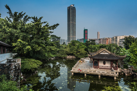 walled: pagoda temple by pond at Kowloon Walled City Park in Hong Kong