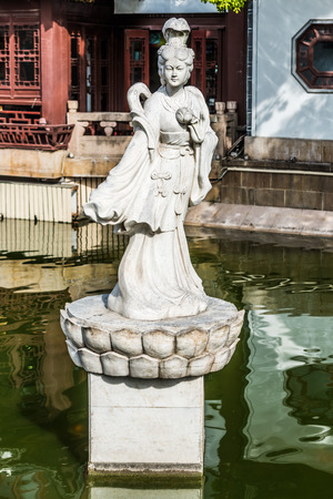fang: ancient statue on a pond in Fang Bang Zhong Lu old city Shanghai China Stock Photo