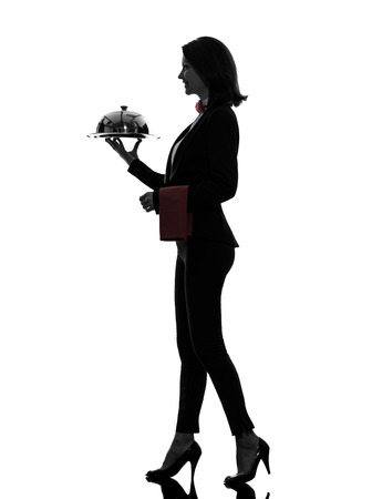 one  woman waiter butler serving dinner with catering dome in silhouette on white background photo