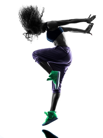 zumba: one african woman in studio silhouette isolated on white background