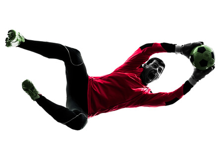 goalie: one  soccer player goalkeeper man catching ball in silhouette isolated white background