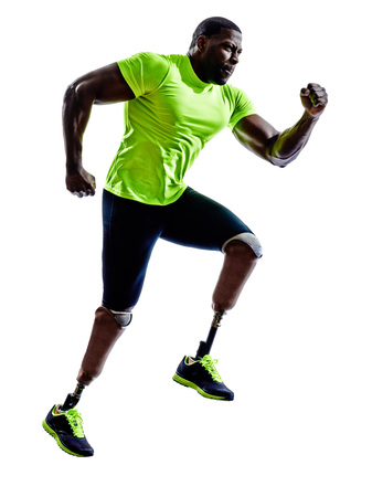 disabled sports: one muscular handicapped man with legs prosthesis in silhouette on white background
