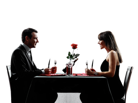 greediness: couples lovers dinning hungry in silhouettes on white background