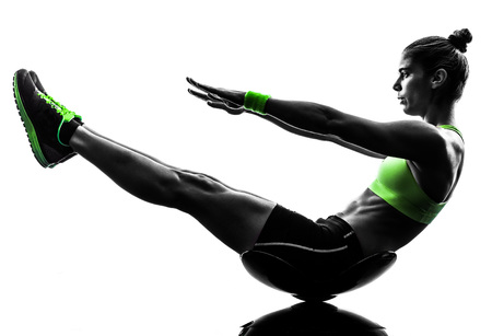 one caucasian woman exercising  crunches fitness in studio silhouette isolated on white background Stock Photo