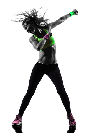 an action: one  woman exercising fitness dancing in silhouette on white background