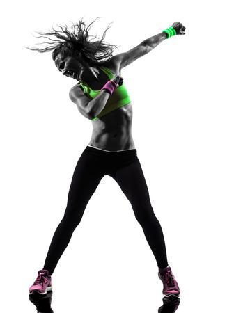 mujeres fitness: una mujer el ejercicio de la danza de la aptitud en silueta sobre fondo blanco