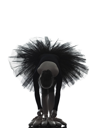 ballerina silhouette: one  young woman ballerina ballet dancer dancing with tutu in silhouette studio on white background Stock Photo