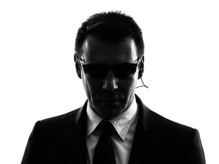 白の背景にシルエットの 1 つのシークレット サービス セキュリティのボディー ガード エージェント男 写真素材