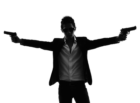gunman: one asian gunman killer portrait shooting in silhouette isolated white background