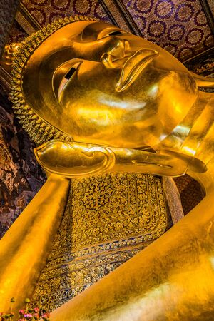 reclining buddha portrait at Wat Pho temple Bangkok Thailand photo