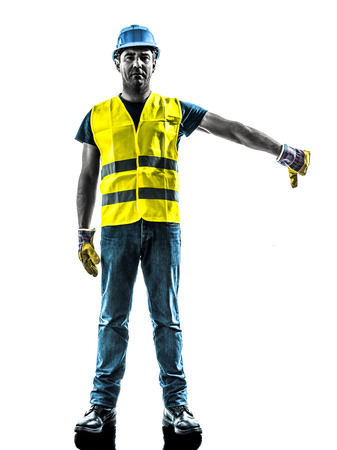 signaling: one construction worker signaling with safety vest lower boom silhouette isolated in white background Stock Photo