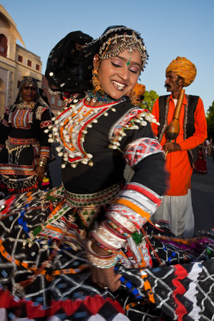 jaipur: Jaipur, India - March 30, 2009 : women dancing in traditional costume  are celebrating the gangaur festival  in jaipur rajasthan india