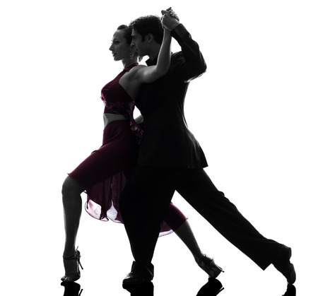 one  couple man woman ballroom dancers tangoing in silhouette studio isolated on white background Foto de archivo
