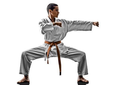 fighting arts: one karate kata training teenagers kid isolated on white background Stock Photo