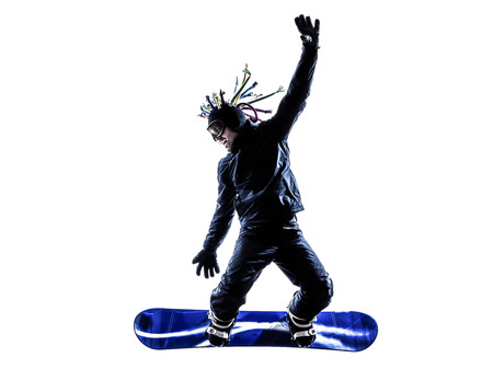boarders: one  young snowboarder man in silhouette white background