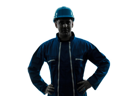 worker construction: one  man construction worker smiling friendly silhouette portrait in studio on white background