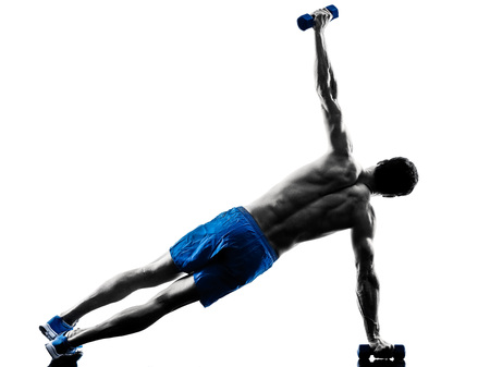 topless: one caucasian man exercising fitness plank position exercises in studio silhouette isolated on white background Stock Photo