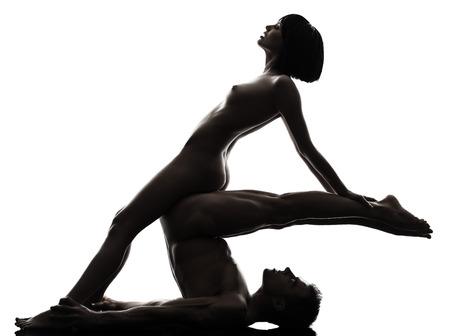 one  couple man woman sexual kamasutra posture love activity in silhouette studio on white background Stock Photo