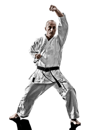 kata: one karate kata training man isolated on white background