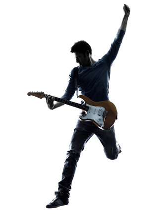 music player: one caucasian man electric guitarist player playing in studio silhouette isolated on white background