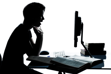 one  young teenager silhouette boy or girl studying with computer computing laptop in studio cut out isolated on white background photo