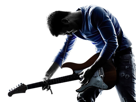 man playing guitar: one caucasian man electric guitarist player playing in studio silhouette isolated on white background
