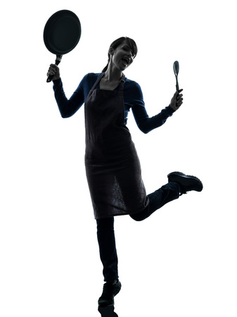 one  woman happy cooking holding frying pan in silhouette studio isolated on white background photo