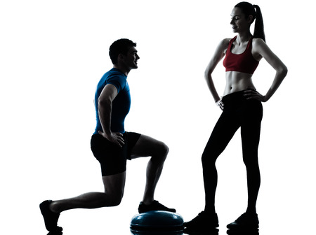 lunges: personal trainer man coach and woman exercising squats on bosu silhouette studio isolated on white background