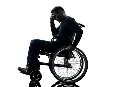 one handicapped man head in hands in silhouette studio on white background