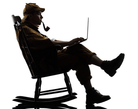 Detective With Computer Laptop Silhouette Sitting In Rocking