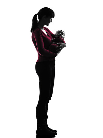 nanny: one  woman holding baby silhouette on white background Stock Photo