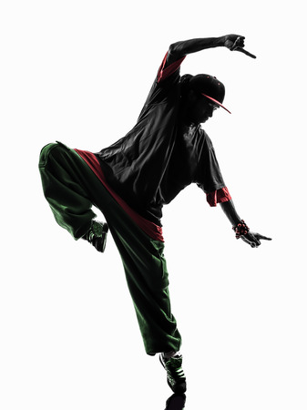 breakdancing: one hip hop acrobatic break dancer breakdancing young man silhouette white background