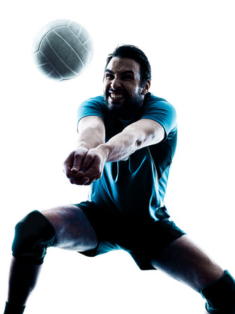 one caucasian man volleyball in studio silhouette isolated on white background photo