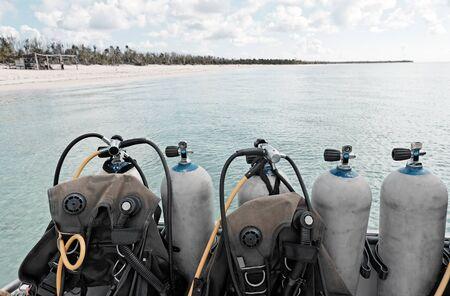 scuba diving equipment on a boat on a sea Фото со стока