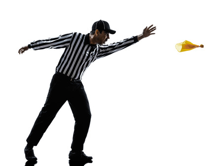 penalty flag: american football referee gestures in silhouette on white background