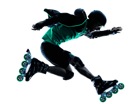 skaters: one caucasian man Roller Skater inline  Roller Blading in silhouette isolated on white background