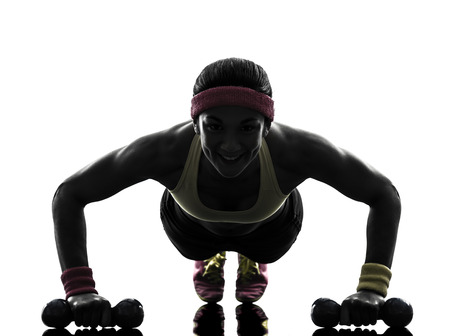 push ups: one woman exercising fitness workout push ups in silhouette on white background