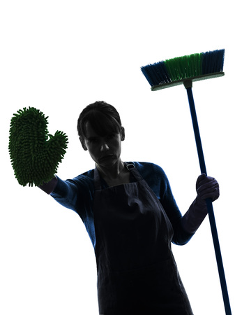 brooming: one  woman maid cleaning brooming stop gesture in silhouette studio isolated on white background Stock Photo
