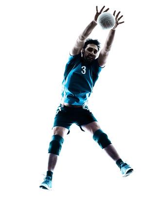 pelota de voley: un hombre caucásico de voleibol saltando en el estudio de silueta aislados sobre fondo blanco en el estudio de la silueta aislado en el fondo blanco Foto de archivo