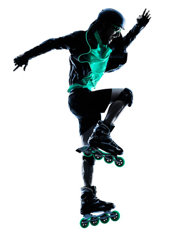 blading: one caucasian man Roller Skater inline  Roller Blading in silhouette isolated on white background