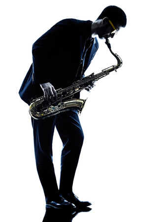 playing music: one caucasian man  saxophonist playing saxophone player in studio silhouette isolated on white background