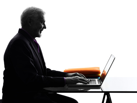 man using computer: One Caucasian Senior Business Man computing laptop smiling Silhouette White Background