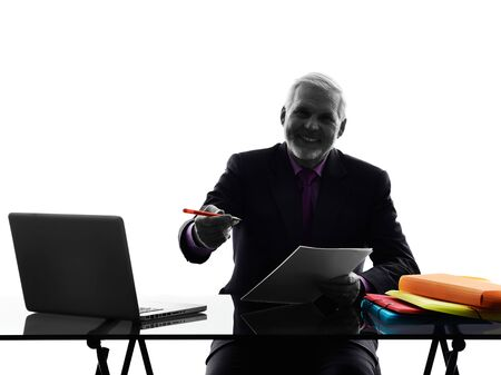 senior business man: One Caucasian Senior Business Man busy working Silhouette White Background