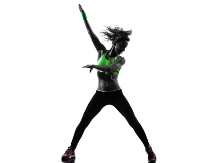 zumba: one african man exercising fitness zumba dancing in silhouette on white background Stock Photo