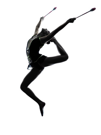 practicing: one caucasian woman exercising Rhythmic Gymnastics in silhouette isolated on white background