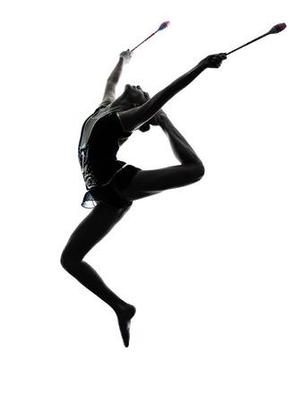gymnastique: une femme caucasien exercice de gymnastique rythmique en silhouette isol� sur fond blanc