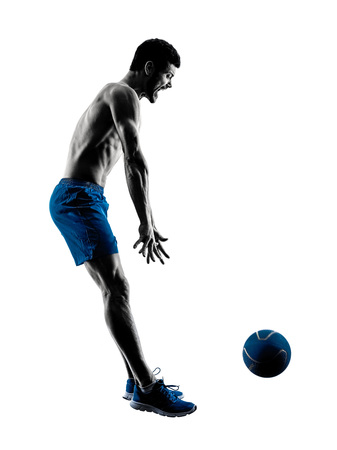 topless: one caucasian man exercising fitness weights Medicine Ball exercises in studio silhouette isolated on white background