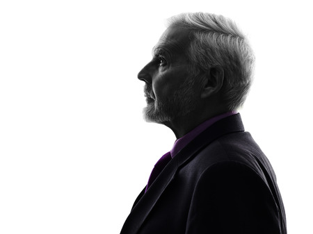 studio portrait: One Caucasian Senior Business Man Silhouette White Background