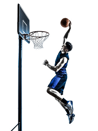 one  man basketball player jumping dunking in silhouette isolated white background Фото со стока